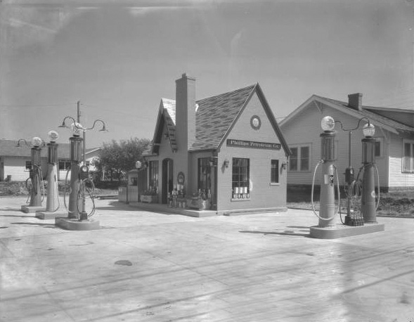 Cottage-style Phillips 66 service station on Elgin