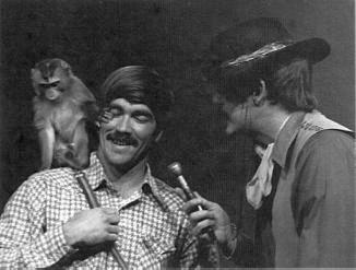 Larry Nunley 'escorts' a squirrel monkey onto the show