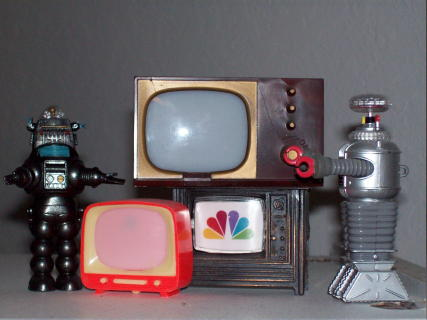 The webmaster's TV robots. Two of the sets are courtesy of Chris Sloan. Photo by Mike Ransom.